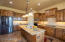 Beautiful high-end Alder Cabinetry, grade 5 slab granite