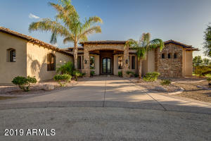 Front of home with Superstition Mountain View