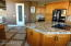 High end kitchen cabinets with granite countertops.