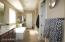 This master bath has separate sinks, jet tub, large shower and an enormous walk-in closet (you have to see it to believe it)!
