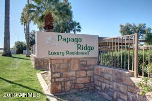 This cozy ground floor single level condo has one bedroom, one bathroom. This is a highly desirable gated community with immaculate landscaped mature grounds and numerous community facilities.. The kitchen has tiled granite counter tops with stainless steel appliances. There is a washer and dryer. The unit is located close to the pool and Jacuzzi.  The Papago Ridge condo community is  located close to the 202 and 51 Freeways, the Phoenix Zoo and Botanical gardens.