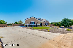 Extra long and wide driveway to your 3 car oversized and over height garage on the cul de sac