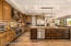 An enormous pantry supports the kitchen with another full refrigerator, not shown.