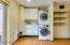 Laundry Room with Built In Cabinets & Sink. Dog Door with Self Watering Station.