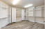 tons of storage and organization in this beautiful master closet