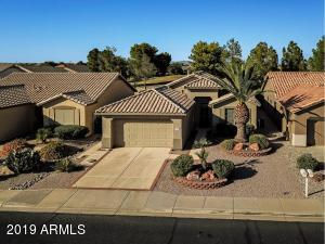 This lovely home is nestled on a GOLF COURSE VIEW LOT in the 55+ guard gated resort of Arizona Traditions!