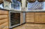Built in wine chiller, wood floors, GE Monogram trash compactor