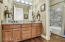2 sinks, granite vanity, custom paint, full bath, shower/over sized tub with granite surround
