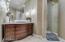 Vintage wood vanity,granite top,vessel sink,Kohler custom faucet with Swarovski crystal,travertine floor