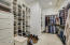 2 large master walk in closets with custom shelves