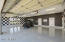 4 car garage/epoxy coated floor and custom faux paint, plantation shutters,enclosed heated and cooled storage room.