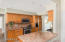 Remodeled Kitchen with Stainless Steel Appliances, Granite Countertops, and ample flush lighting.