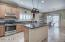 Eat-in kitchen with stainless Appliances w/gas stove, neutral cabinets and kitchen island
