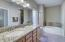 Dual sinks in Master Bath with granite counter, under mount sink and separate shower & tub