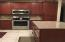 Gorgeous Remodeled Kitchen. Cherry wood Cabinets & rich looking Quartz Counters