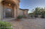 Inviting entry courtyard with waterfeature and pond.