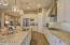 Lovely pendant lights over the kitchen Granite Island