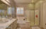 Dual Sinks in the Master Bathroom with separate shower and soaking tub.