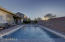 Wide Baja Shelf in the pool for shallow water swims or lounge chair relaxing.