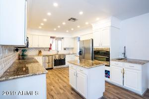 Granite counters, farm sink, dual oven...WOW!