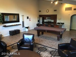 Large community room with pool table , fireplace and kitchen