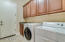 INSIDE LAUNDRY * SOLID WOOD CABINETS WITH UTILITY SINK