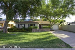 This idyllic ranch home is located in one of the most desirable areas in Arcadia Lite! This prime location is situated near fabulous restaurants and bars, such as Beckett's Table, La Grande Orange, Postino, The Vig, and the newest cocktail bar, Century Grand. Right as you walk into the home, you're greeted by an open floor plan with multiple living spaces and an upgraded kitchen with custom cabinetry. The guest bedroom and both master suites feature bamboo wood floors and plenty of natural light. Outside, the expansive backyard is lined with mature trees for privacy and park-like setting. Come and see it today before it's gone!