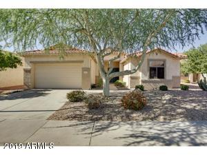 This lovely home is located in the 55+ guard gated community of Arizona Traditions