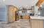 Contemporary kitchen with brand new granite counter tops and stainless steel appliances