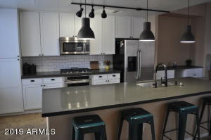 Enjoy cooking in your new kitchen with upgrade appliances and new Quartz countertops