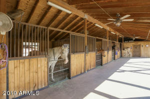 Your barn has stalls, tack room, grooming station, fly system, shades on the western side, misting system and feed room.