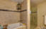 Aromatherapy jetted tub and a separate walk in shower.