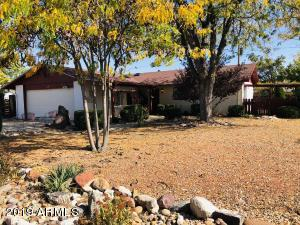 Welcoming, low maintenance front yard with mature trees on a quiet street.