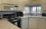 B/I Microwave and dishwasher. Front kitchen with street view