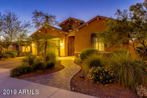 Paver driveway and walkway, low maintenance landscaping and beautiful architecture give this home wonderful curb appeal