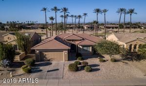 This lovely golf course property with a heated pebble tech swimming pool and spa is located in Sun City Grand!