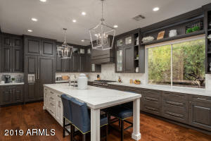 Remodeled kitchen with custom cabinetry and large island with seating area.