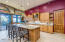 Granite slab counters & knotty Alder cabinets match the doors throughout