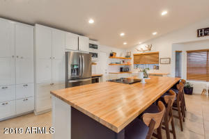 Newly remodeled open kitchen with huge butcher block island. Perfect for entertaining.