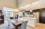 Upgraded kitchen with wood tile flooring and quartz countertops
