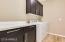 Laundry room with custom cabinetry and quartz countertops