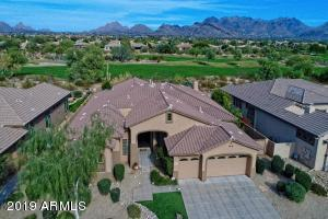 Aerial view of home with stunning golf course and McDowell Mountain Views