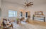 You will find gorgeous wood plank tile and oversized ceiling fans throughout the living room and great room.