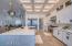 Beautiful Calacatta quartz is throughout the kitchen- countertops/backsplash and an oversized waterfall island.