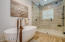 The Jack and Jill bathroom features a gorgeous large shower and a freestanding tub.