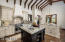 This gourmet kitchen is both beautiful and functional with a Wolf/Subzero appliance package