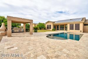Check out the pool, patio, full bbq and fireplace.