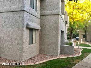 Quiet Corner unit surrounded with shade and flowering trees