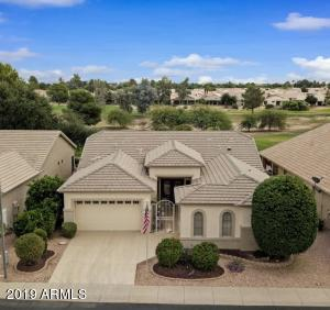 Welcome to 17419 N. Goldwater Drive in the guard gated 55+ community of Arizona Traditions!
