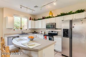 Updated kitchen cabinets, stainless steel appliances.